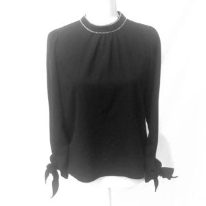 Black fashion blouse with embroidered neckline
